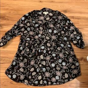Light floral button down with flared bottom.